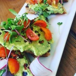 Sun Café: Focaccia bread topped with mashed avocado, red pepper flakes, and tomatoes