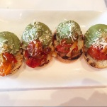 Local Table: Small crostini topped with half tomato mixture half purred avocado